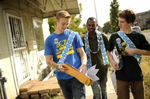 Jabari Smith, organizer with Obama for America in Denver, center, Brian Winstanley, 17, left, and Andrew Schwartz, 16, of East High School check the map for canvassing in Five Points. (Hyoung Chang, The Denver Post)