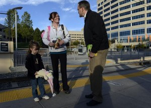 "State Rep. Joe Miklosi greets Richelle Hentemann and her daughter, Madison, 4, at a light-rail station near I-25 and Orchard Road in Greenwood Village. ""He's a very diligent, earnest and driven individual,"" said former House Speaker Andrew Romanoff. (Andy Cross, The Denver Post)"
