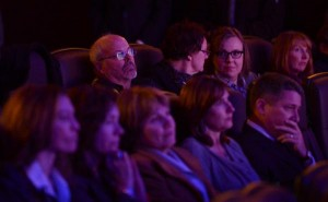 Tom Sullivan, left rear, whose son Alex was slain in the Aurora theater shooting, watches the reopening ceremony with family members Thursday in Auditorium I, the remodeled Theater 9 of the Century Aurora theater. (RJ Sangosti, The Denver Post)
